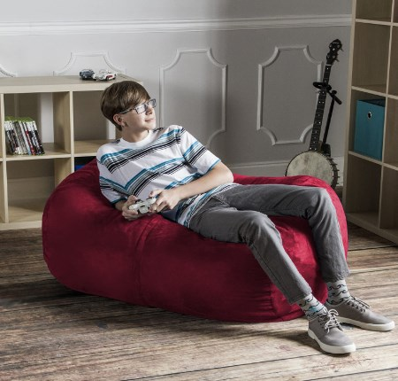 """Jaxx Bean Bags Sofa Saxx Bean Bag Lounger, 4-Feet, Blueberry Micro Suede Jaxx bean is a perfect choice for teenager and adults due to its awesome features. It is 100% polyester that is imported and made in USA. The 4 feet bean bag is perfect for teens and adults. It can be placed in home theatre, dorm, game room and playroom etc. It comes already assembled. Your children can enjoy the playing games or taking snap on it. The dimension of the lounger is 46""""D x 34""""W x 26""""H. Just zip up the cover and you will find the new bean bag lounger. Some people complaint that when you use a lot the bean bag then it became compressed with time. It is shredded polyurethane foam which is soft and comfortable. It maintain its shape. The outer cover is mircosuede that is removable and washable. The inner liner built-in childproof zipper It offer one year warranty. There are multiple colors and size. You can select your favorite colors and body size. Even dogs and cats love it to sit and sleep on it because of its soft and comfortable features."""